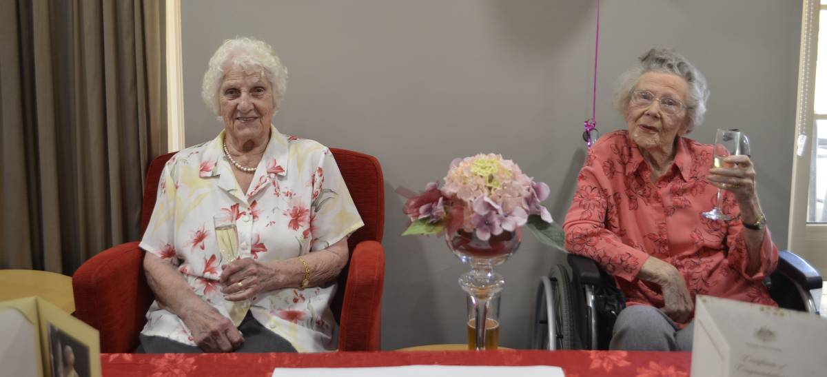 Cheers to two centuries: Doreen Arnold and Margaret Littlewood enjoy a champagne to celebrate their 100th birthday at Estia Health Encounter Bay.