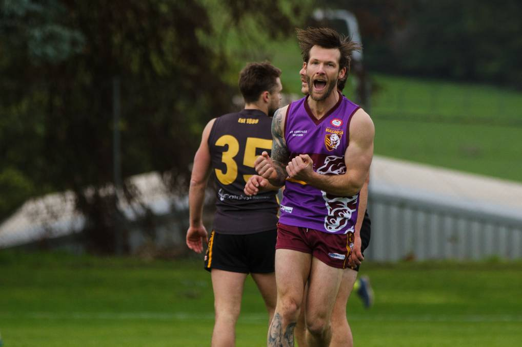 Celebration: Mount Compass' Timothy Green celebrates a goal in his side's win against Yankalilla, which saw the Dogs confirm second spot and a double chance.
