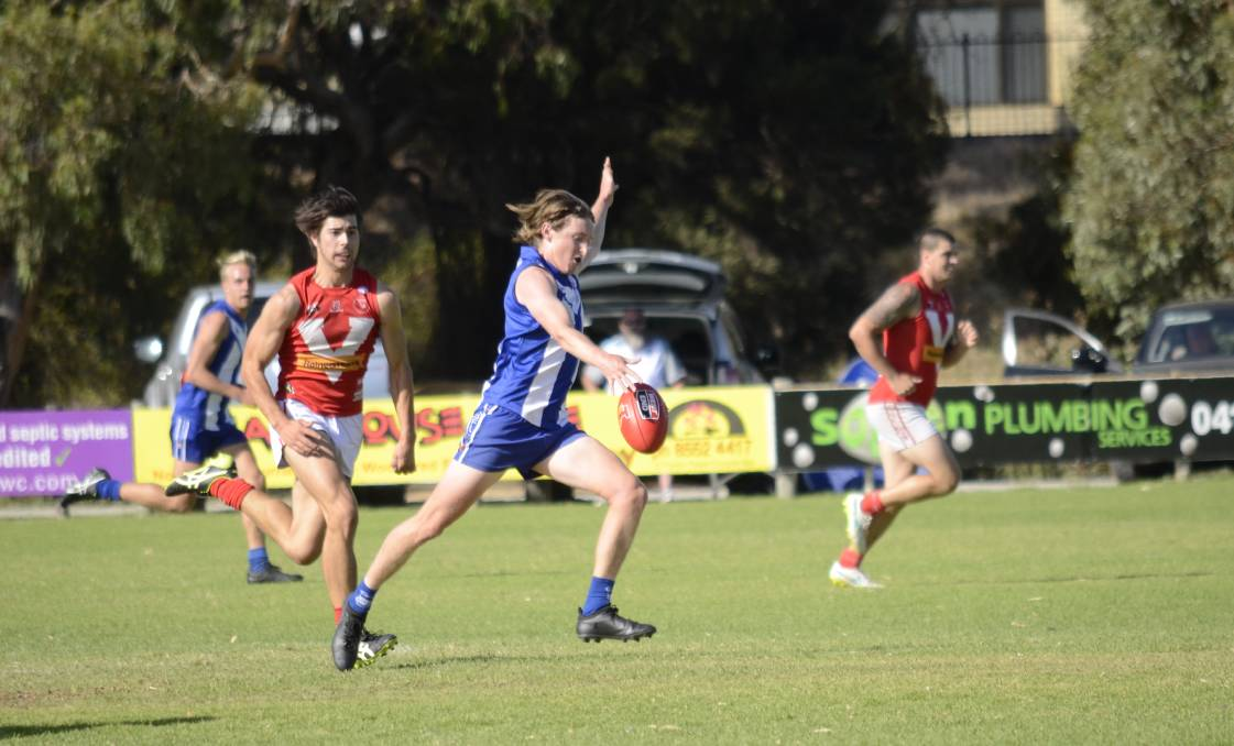On the move: James Bramley cuts up the middle of the ground, providing Victor's forwards with first access to the ball during a tight 7 point win.