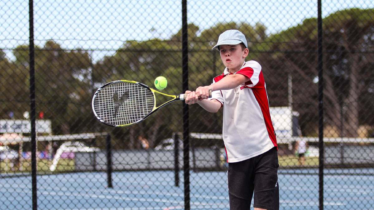 STRIKE: Anderson Jeffery from Normanville won the under 13 title on Saturday at the Victor Harbor courts.