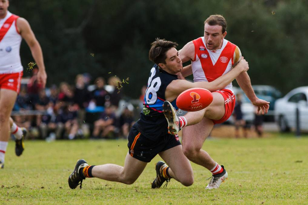 GIVING EVERYTHING: McLaren's Ashley Goodieson throws himself onto the boot of Willunga's Braden Altus on Saturday. Willunga won the match by one point.